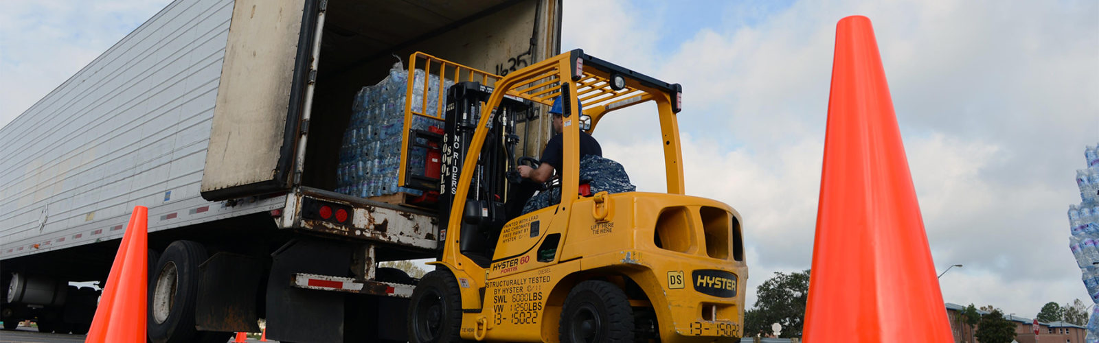 A U.S. Sailor uses a forklift to unload bottled water from a truck Sept. 1, 2012, at Naval Air Station Joint Reserve Base New Orleans after Hurricane Isaac struck the area. Isaac developed as a tropical storm over the Western Atlantic Ocean Aug. 21, 2012, affecting Puerto Rico, the Dominican Republic, Haiti and Cuba before making landfall as a hurricane on the Gulf Coast of the United States. (U.S. Navy photo by Mass Communication Specialist 2nd Class Josue L. Escobosa/Released)